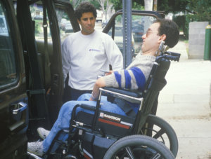 car driver helping a disabled person